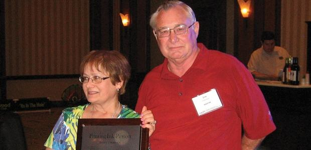 Janet Ciravolo, left, receives the Pioneer Award from Jim Coleman, NAPIM's former executive director.