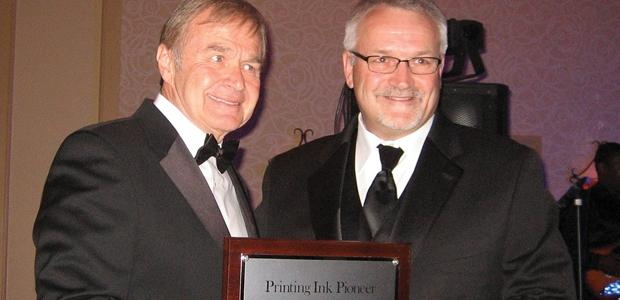 John Hrdlick, right, receives the Pioneer Award from NAPIM  president George Sickinger.